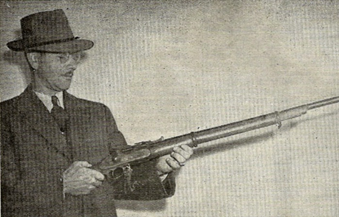pioneer man with early model rifle