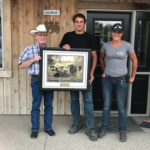 Brian Good (l) of the Canadian Angus Association presents the award to Jordan and Megan Kolk.