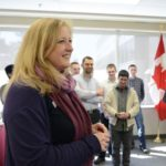 Transport Minister Lisa Raitt, shown here last month at Carleton University, says she doesn't yet plan to mandate minimum grain traffic levels in specific rail corridors. (TC,gc.ca)