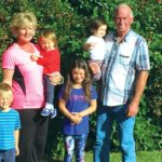 Brian and Connie Chrisp with their grandchildren.