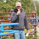 Lee Carpenter answers questions about his mixed farming operation, during the Saskaskatchewan Forage Council's pasture tour near Hanley, Sask.