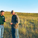 Cannon Smith answers questions on using Herdly from rancher Travis Hartley of Aetna, Alta.