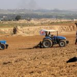 Palestinian farmers, helped by the International Committee of the Red Cross (ICRC), use tractors to plow a field near the Israel Gaza border in the central Gaza Strip on Feb. 3, 2020. (Photo: Reuters/Ibraheem Abu Mustafa)