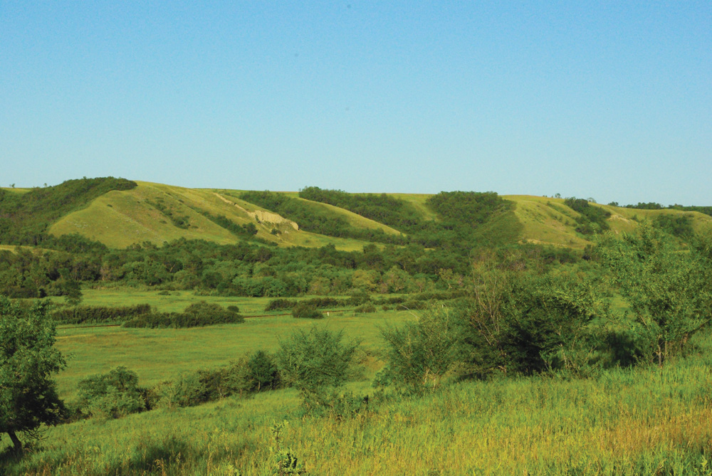 Landscape in the Qu'Appelle Valley, about 30 km. north of Regina, Sask. Consider location and logistics when deciding where to purchase land.