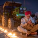 A farmer prays to mark the 551st birth anniversary of Guru Nanak Dev, the first Sikh Guru and founder of Sikh faith, at Singhu border near Delhi on Nov. 30, 2020, at the site of a protest against newly passed farm bills. (Photo: Reuters/Danish Siddiqui)