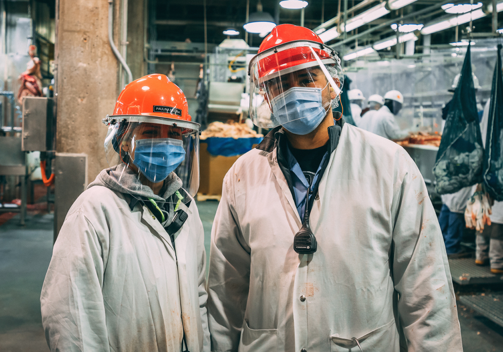Masks, face shields and plastic barriers between work stations are examples of the health and safety protocols at Cargill to protect workers from COVID-19.