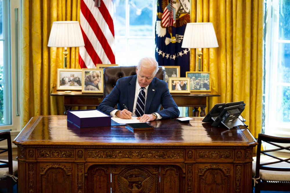 President Joe Biden signs the American Rescue Plan in the White House Oval Office, March 11, 2021.