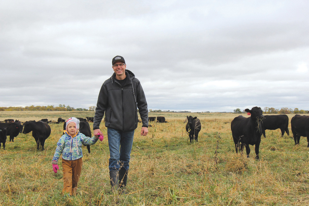 Ryan Boyd and his daughter Piper during a farm media tour in the fall of 2018.